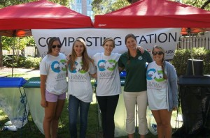 Abby Tennenbaum (center) helps with a composting station
