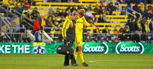 Lagow assisting a Columbus Crew player off the field.