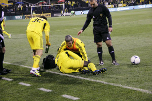 Dave Lagow '01 assisting a Columbus Crew player hurt on the field.