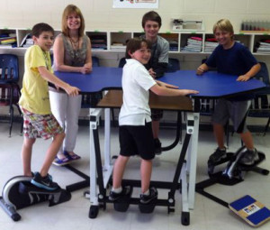 Fifth-grade teacher Stacey Shoecraft and her students demonstrate exercise desks at Pinckney Elementary School in Mount Pleasant, S.C.