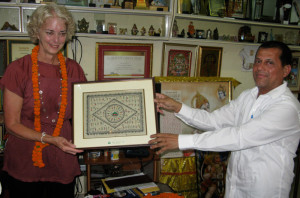 On a trip to India with students in 2012, Christine Finnan met with KISS founder Achyuta Samanta.