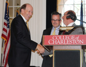 Board of Trustees Chair Greg Padgett (right) congratulates President George Benson.