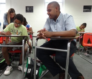 Professor Michael Hemphill helps ninth grader Jerry Manigault with homework.