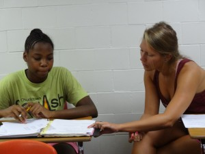 Senior exercise science major Lauren Lizewski helps Jerrica Manigault with homework.