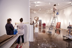 Exhibiting student artists installing their works in the Halsey Institute of Contemporary Art galleries.