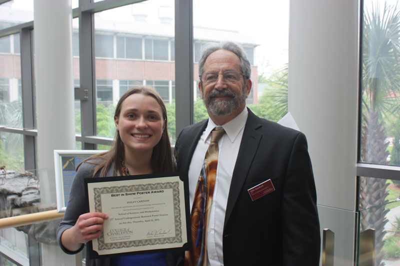 """Dean Mike Auerbach presents Haley Cabaniss with a """"Best in Session"""" award for her research of YY."""