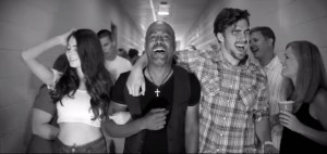 "CofC junior Greg Keys (at right) appears with Darius Rucker in the music video for ""Homegrown Honey."""