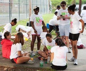 Debra Gammons '87 enjoys a laugh with volunteers at the 5k race she established in honor of her mother. Photo: PaulAlfordPhotography.com
