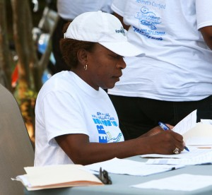 Debra Gammons '87 compiles registration forms at the Run for Your Mother 5k. Photo: PaulAlfordPhotography.com