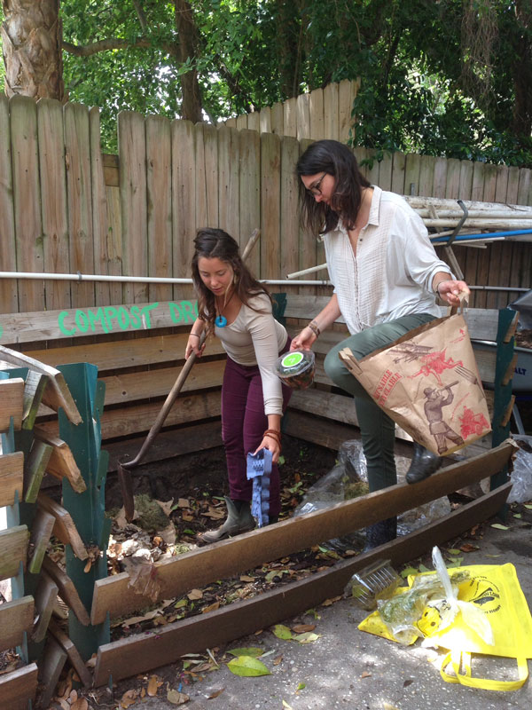 Keane and Ava Gettinger '15 get down and dirty in a campus compost bin.