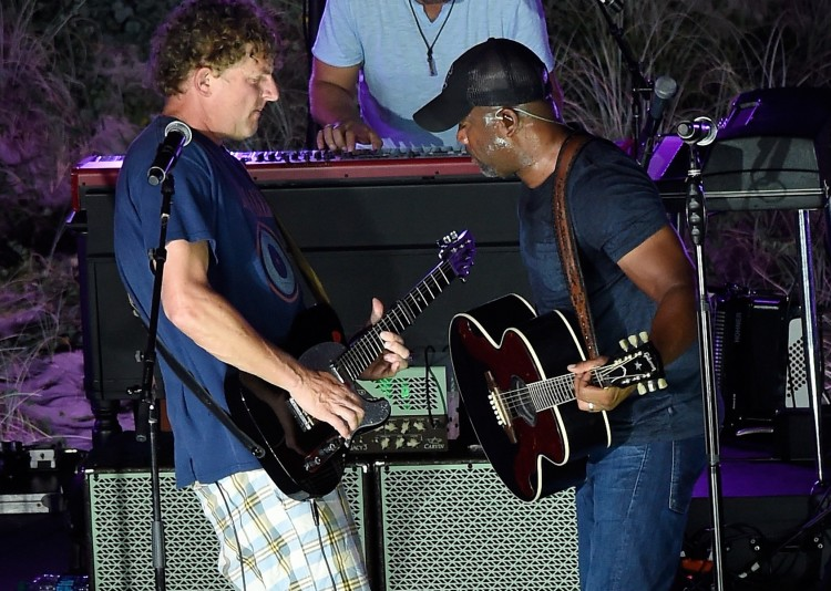 CHARLESTON, SC - AUGUST 26: Mark Bryan (L) of Hootie & the Blowfish joins the stage with Darius Rucker to perform a free, surprise pop-up concert in Charleston for CMT INSTANT JAM: DARIUS RUCKER at The Windjammer on August 26, 2015 in Charleston, South Carolina. The concert premieres September 5 at 10/9c on CMT. (Photo by Rick Diamond/Getty Images for CMT)