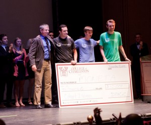 Team Moneta accepts the grand prize of $10,000.