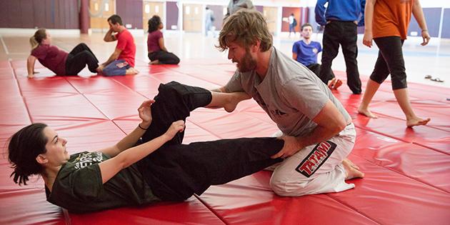Adjunct professor Pat McGuigan and senior Ashley Sprouse practice techniques.