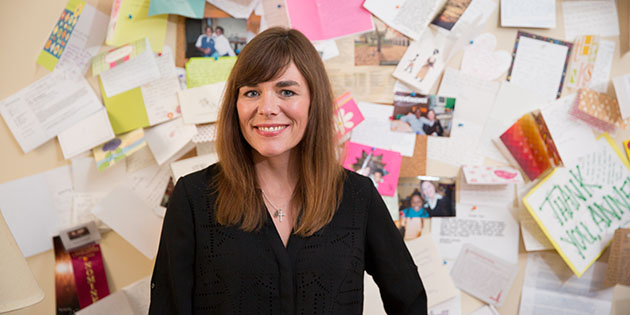 """Professor Anne Gutshall's office walls are covered with """"thank you"""" notes from her students."""