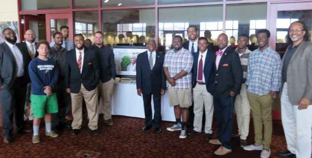 Teacher education professor Renard Harris (far right) and current and former participants in the College's Call Me MISTER Program gather to honor former S.C. Rep. Floyd Breeland (center).