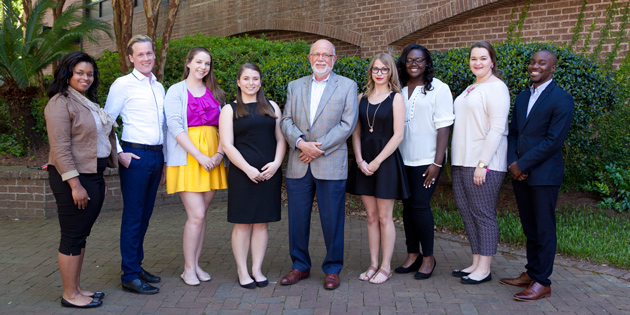 Inaugural Class of Martin Scholars (l-r) with Tom Martin (center): Nia Strothers, Corey Law, Megan Dunn, Berkeley Fisher, Tom Martin, Amanda Phagan, Chelsea Anderson, Caroline Coyle, Jaquan Leonard.