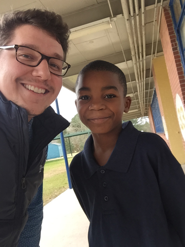 Nicholas Boatwright '11 with one of his students at Orangeburg.