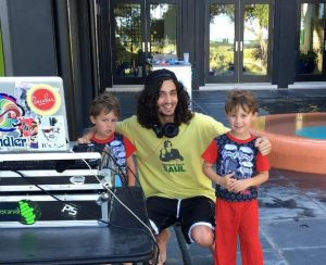 DJ Jared Aaronson flanked by two fans at the MUSC Hollings Cancer Center.