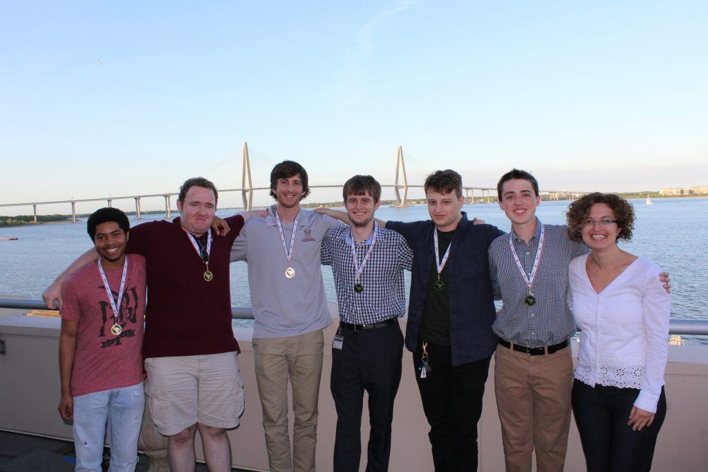Please see pic of team attached. From left to right: Elex Moore (Sophomore), Joshua Yates (Freshman), Jake Schwarztrauber (Senior), Nate Smith (Sophomore), John Anderson (Senior - Team Captain), Blaine Billings (Freshman), and Dr. Xenia Mountrouidou (Assistant Professor of Computer Science).