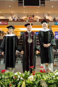 "Elizabeth Colbert-Busch, left, President Glenn F. McConnell and Kenneth ""Mace"" Brown at Spring Commencement on Saturday, May 13, 2017. Colbert-Busch and Brown both received honorary degrees."