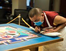 Buddhist Monk Creating Sand Mandala at Addlestone Library