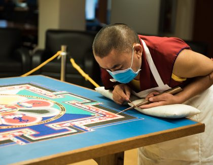 Buddhist Monk Creating Sand Mandala at Addlestone Library