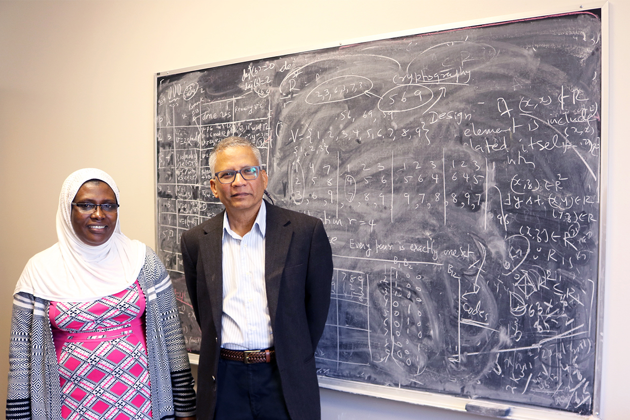 Math professor Dinesh Sarvate (left) and Kasifa Namyalo, a Ph.D. student from Uganda, spent the semester finalizing her thesis in combinatorial design theory.