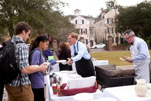 President McConnell serves pancakes during Cougar Countdown.