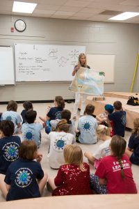 Alumna Hall West gives a lesson on reading maritime charts.