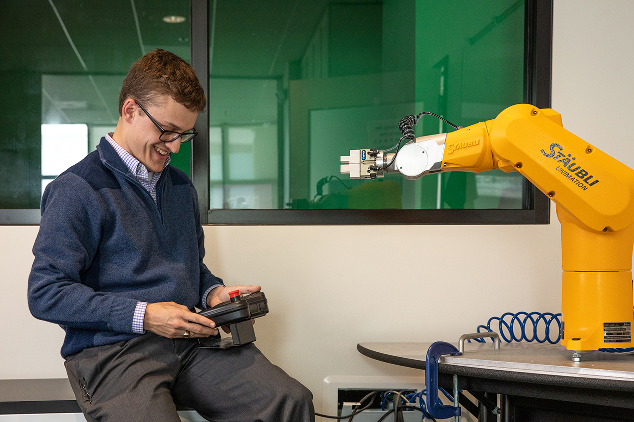 student programs robot arm