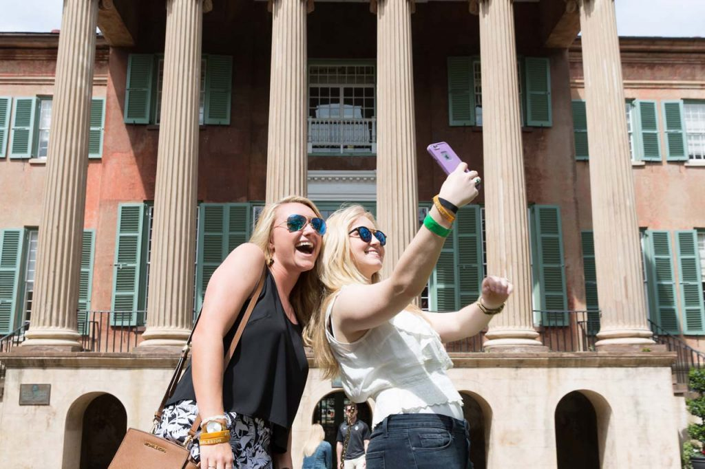 Students take a selfie in front of Randolph Hall.