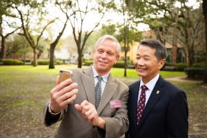 Professor Jon Hakkila and CofC President Andrew T. Hsu pose for a selfie in Cistern Yard.