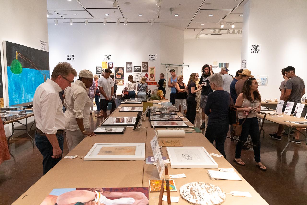 People peruse art at the Halsey Institute's Bizarre Bazaar.