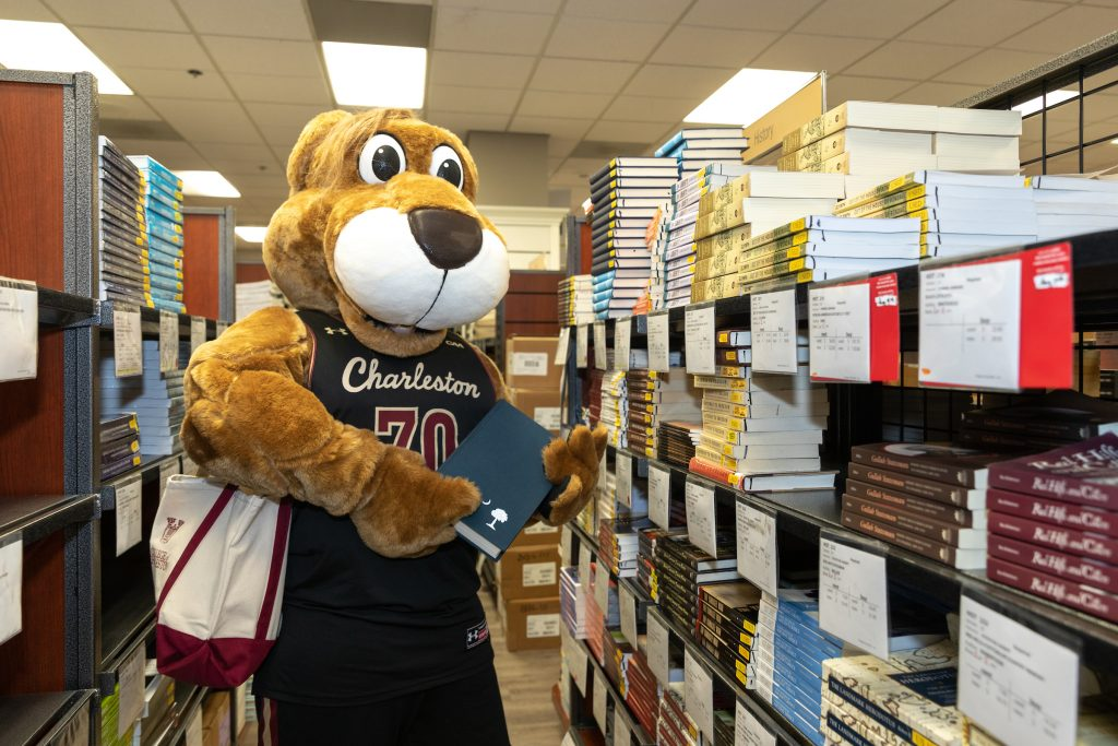 Clyde the Cougar buys books at the bookstore