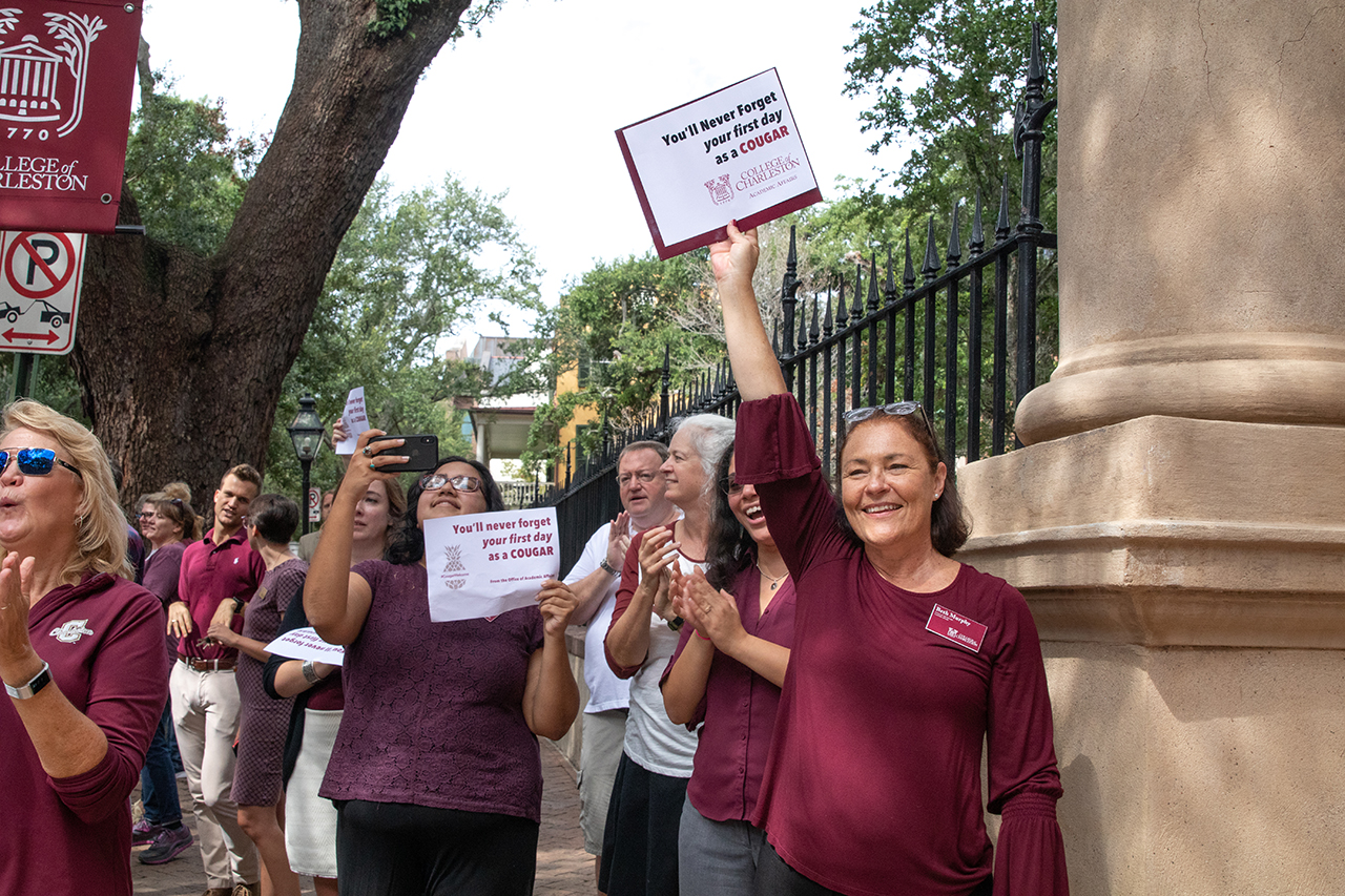 Faculty and staff greet students as they enter cistern yard for convocation