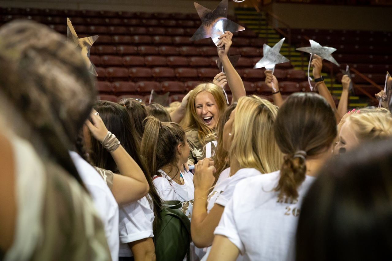 Female students participate in Panhellenic Bid Day at TD Arena