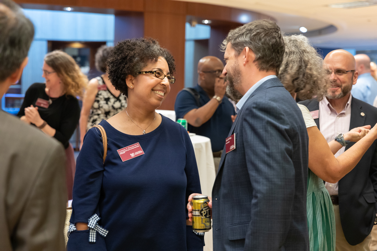 New faculty, deans, board members, Iterim Provost Welch and President Hsu mingle at the New Faculty Reception in the Addleston Library.