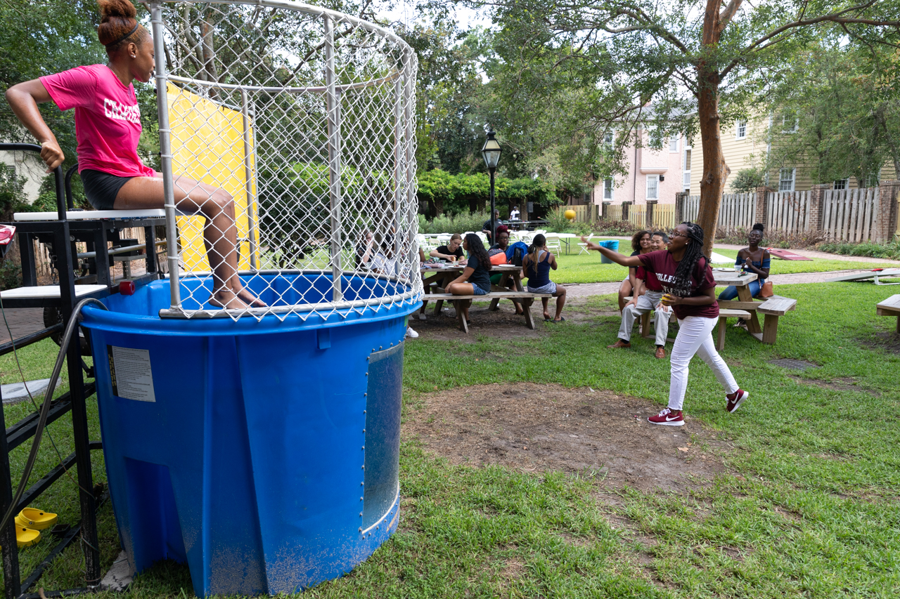 The students of Collegiate Curls and joined by President Hsu gathered to eat, dance and get a chance at to dunk someone in the dunking machine.