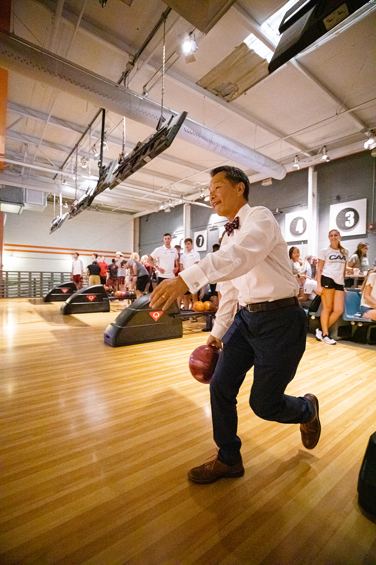 College of Charleston President Andrew T. Hsu bowls at The Alley