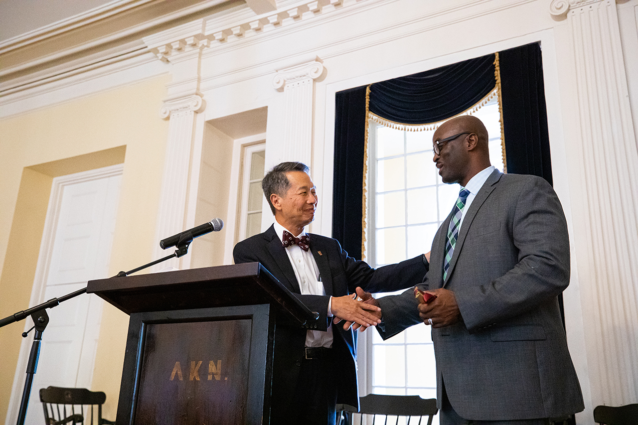 Retiring campus police chief Robert Reese shakes hands with College of Charleston President Andrew Hsu.
