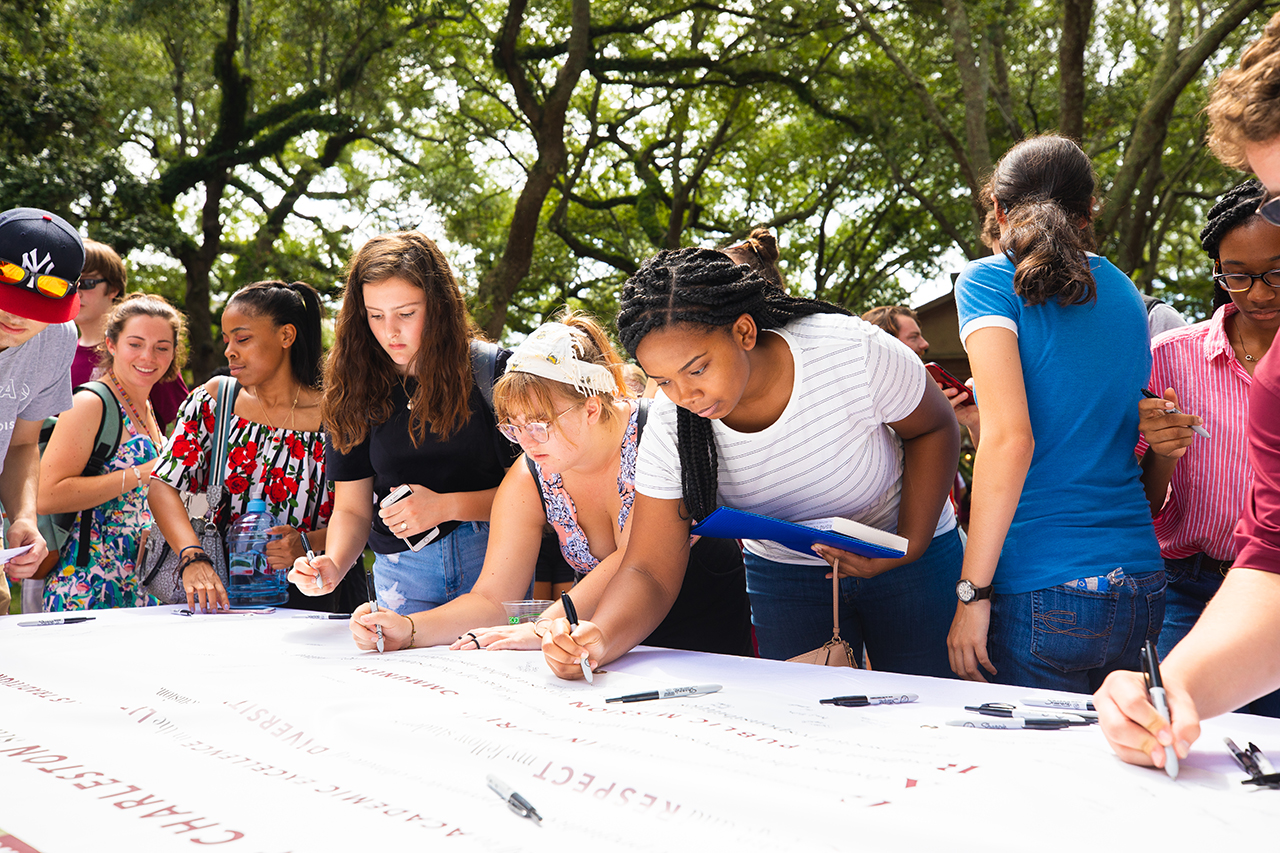 Students sign the College of Charleston Cougar Commitment pledge during convocation.