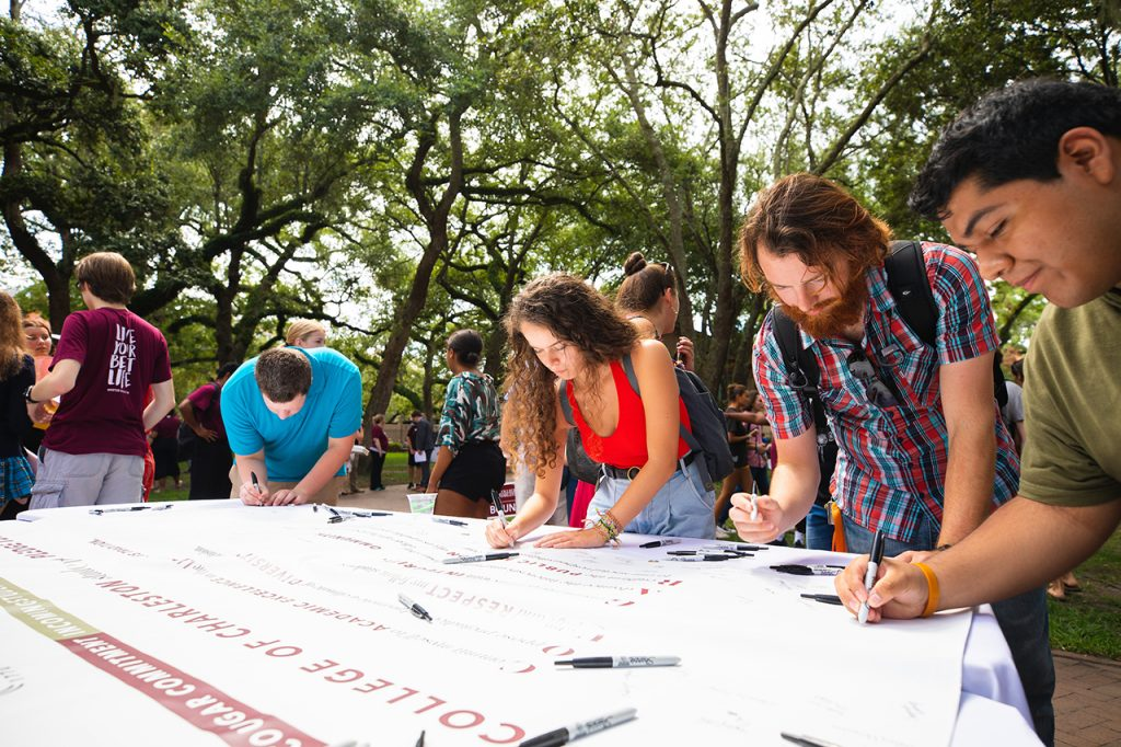 Students sign the Cougar Commitment pledge during convocation
