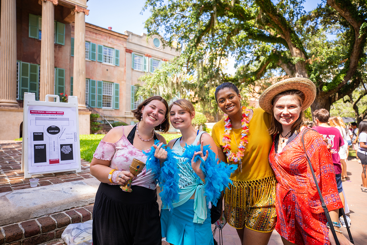 Students participate in the Maroon Mayhem street festival at the College of Charleston