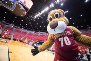 Clyde the Cougar on the basketball court.