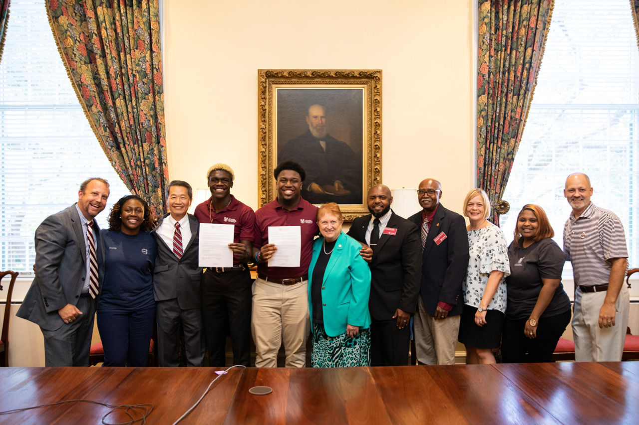 Darius Smith and Jaheim President accept their full ride in the President's Board Room.