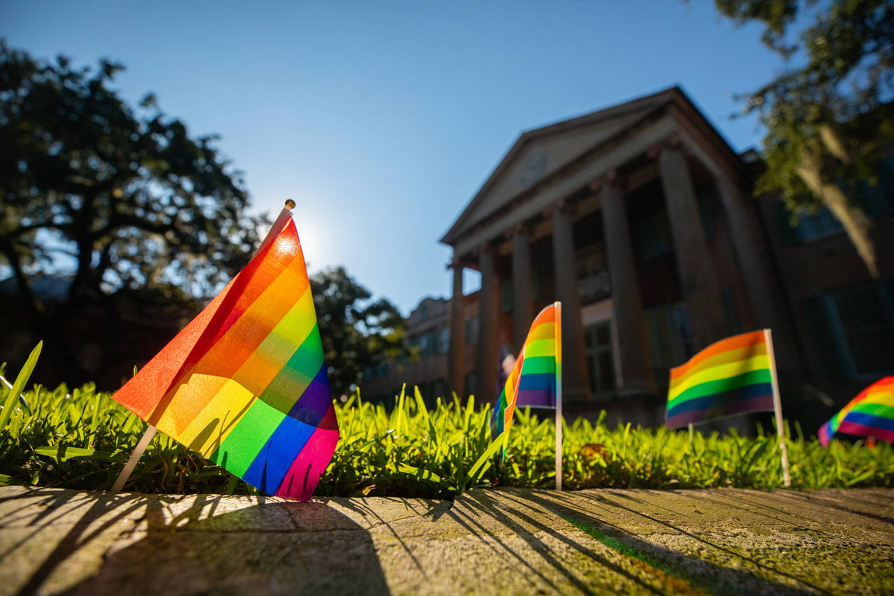 Randolph Hall with pride flags along the Cistern.