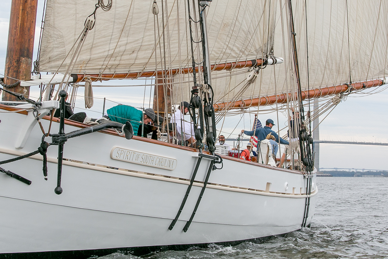 Crew members work aboard the Spirit of South Carolina sailboat.