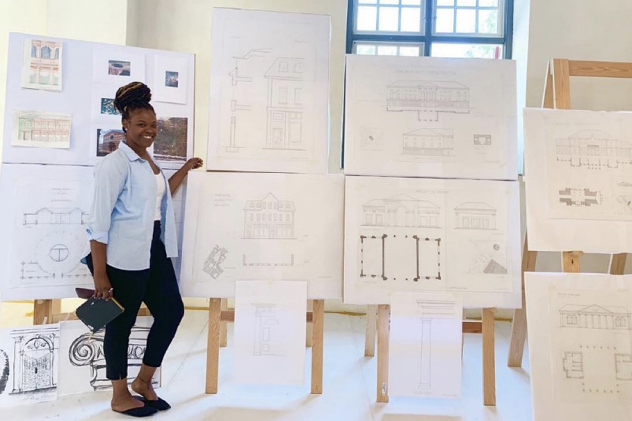 T'Leya Walker in front of blueprints