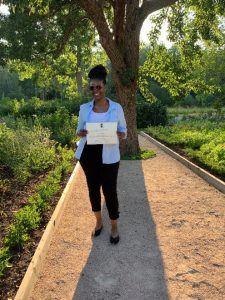 T'Leya Walker holds a certificate for completing the Engelsberg Summer School in Classical Architecture.