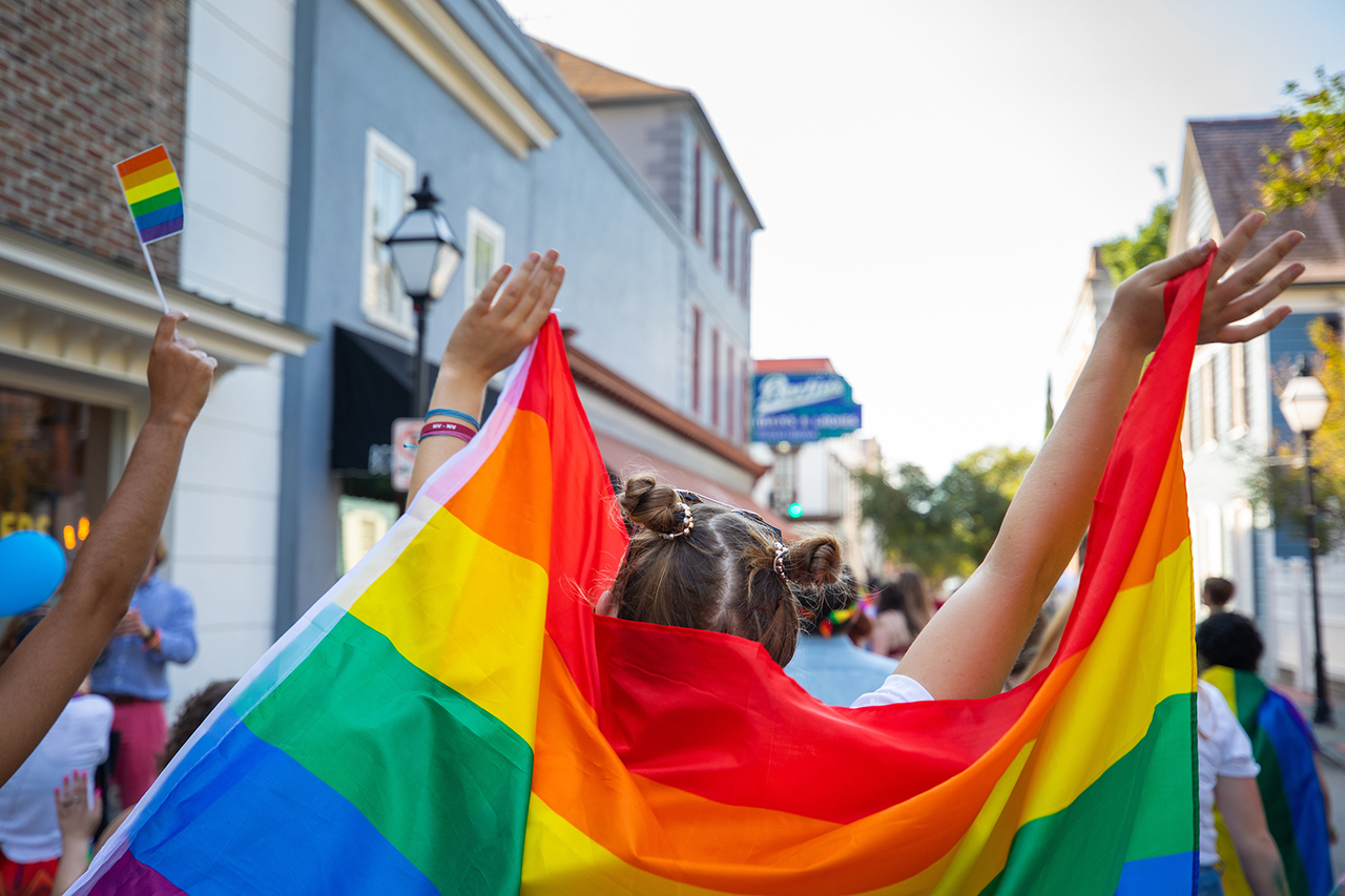 A rainbow flag is displayed at the Charleston Pride Parade.